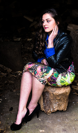 Girl sat on a log deep in thought